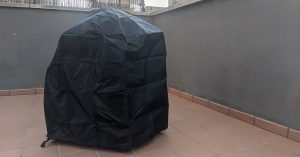 A barbecue with a cover on