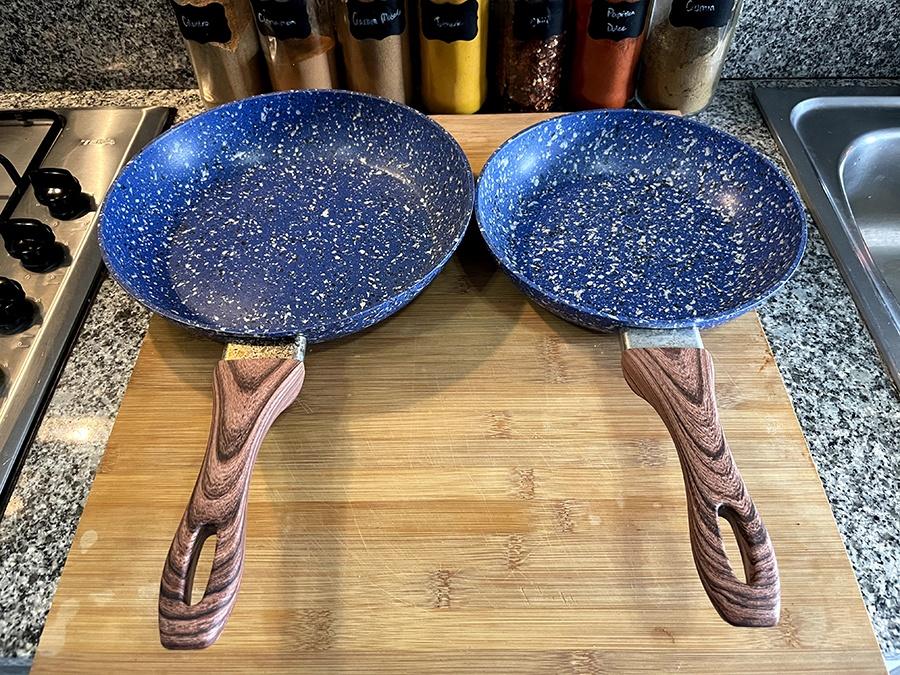 two non-stick blue saute pans