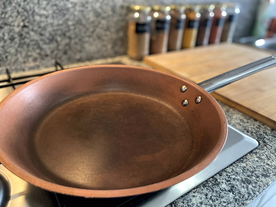 A copper pan that has discoloured from use