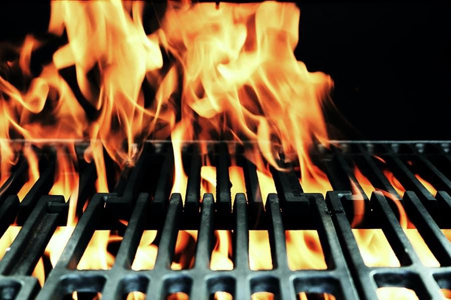 fire burning through cast iron grates